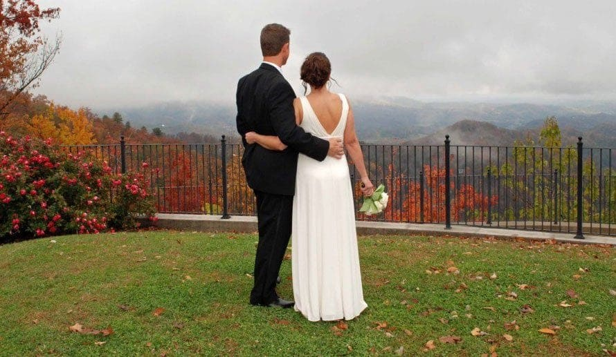 Newlywed couple enjoying scenic Smoky Mountain view from HearthSide at the Preserve