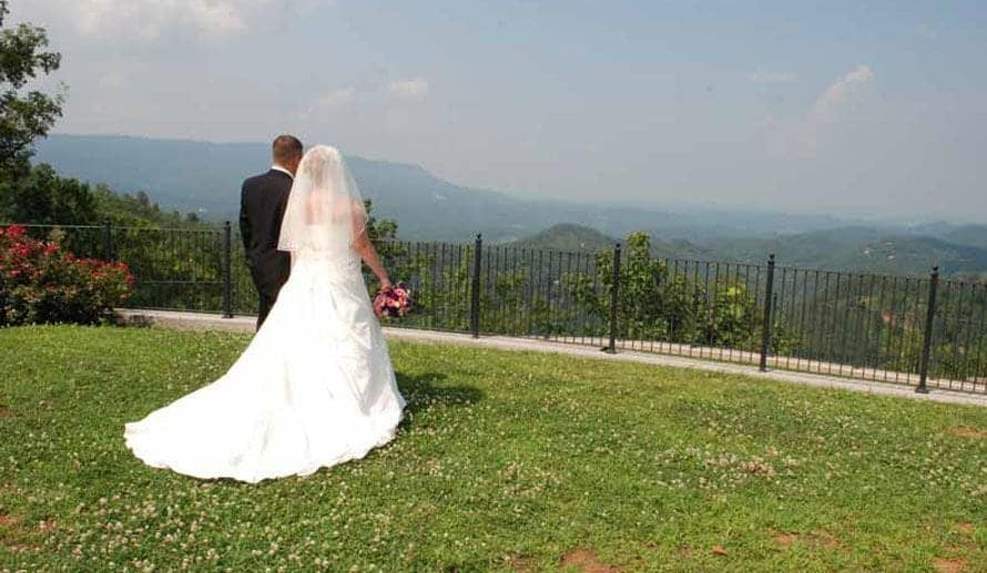 Bride and Groom enjoying a scenic view after celebrating a summer wedding in the Smoky Mountains
