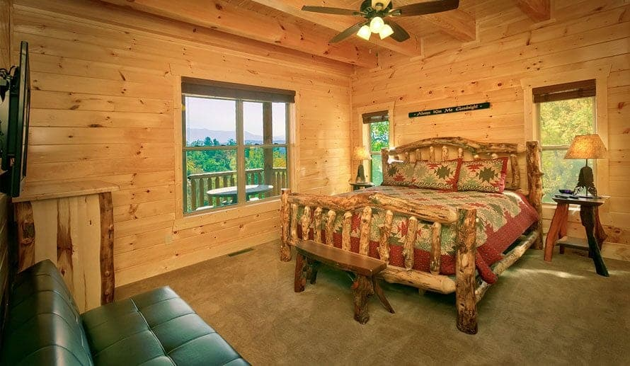 The bedroom of a Smoky Mountain cabin with a charming wooden decor