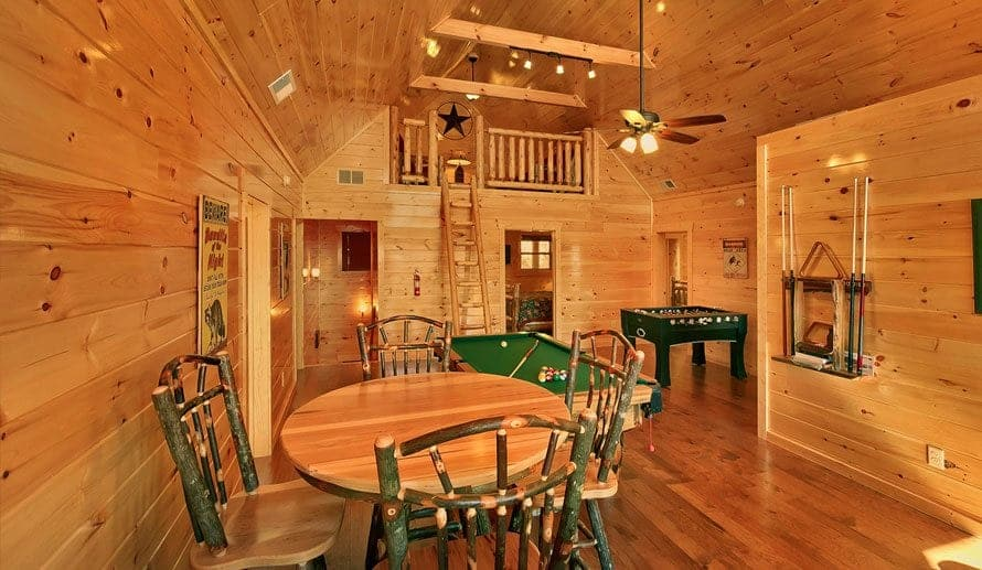 The game room of a Pigeon Forge cabin featuring a pool table and foosball