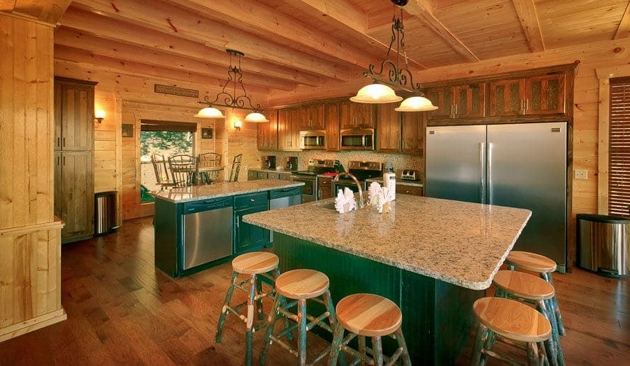 A large kitchen in a Smoky Mountain cabin with granite countertops and ample seating