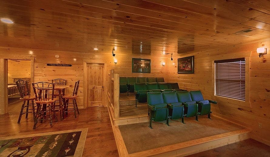 Movie theater style seating in the entertainment room of a Pigeon Forge cabin rental