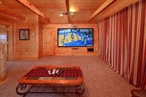 Home theater room inside Mountain Pause Retreat Wears Valley luxury cabins
