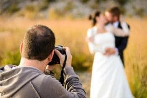 photgrapher shooting a wedding in Gatlinburg TN log cabins