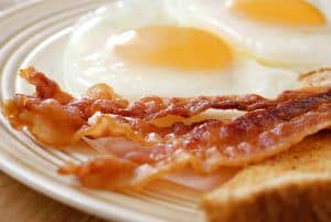 Closeup photo of bacon, eggs, and toast.