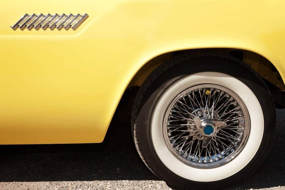 hubcap on yellow classic car