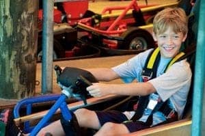 Boy sitting and smiling in a go-kart